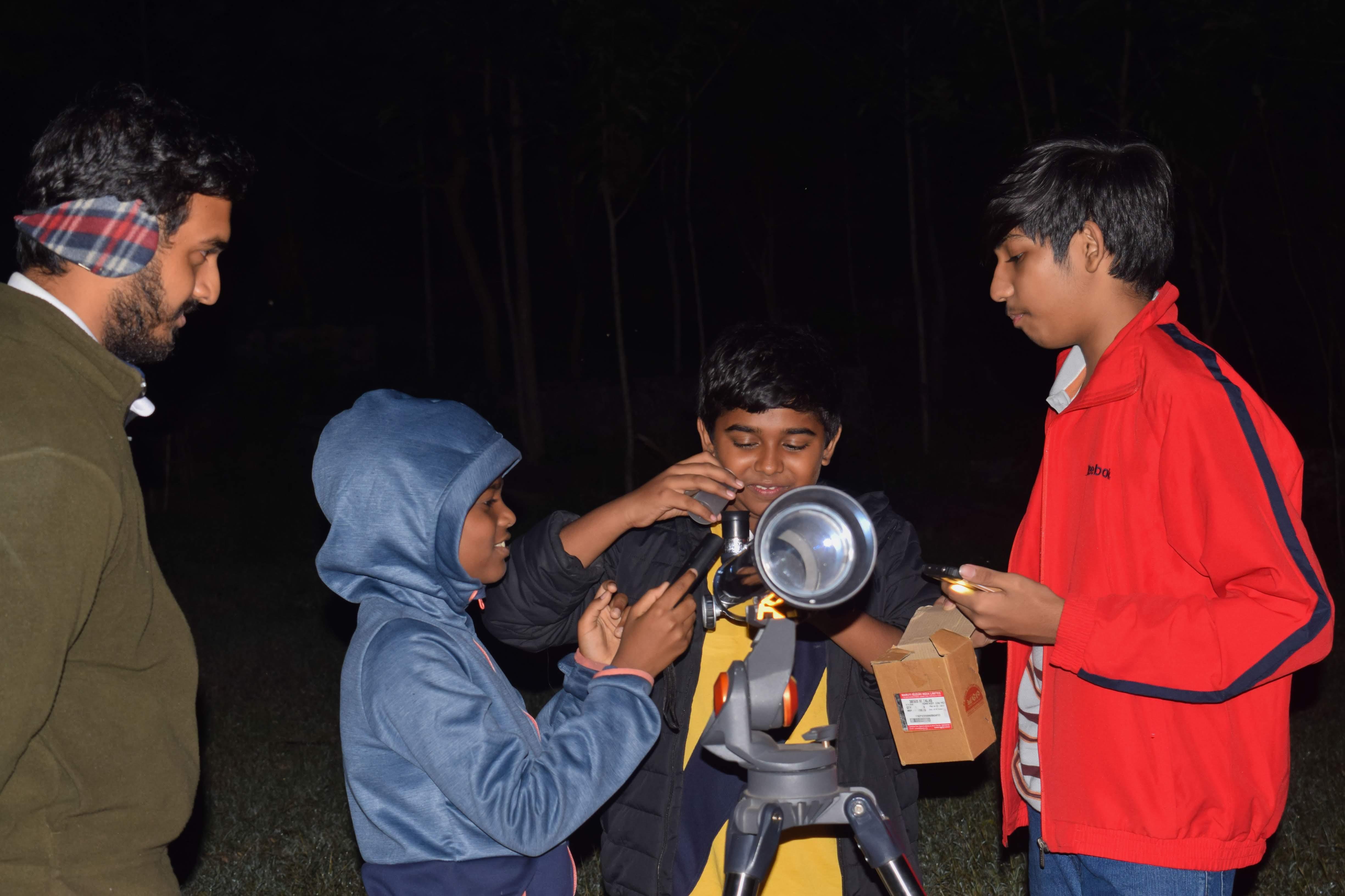 Astronomy camp - kids setup telescope